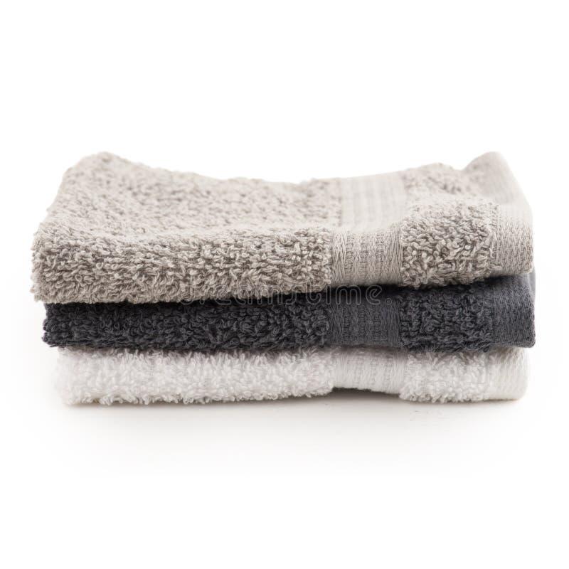Asciugamani di bagno bianchi, neri, grigi immagini stock