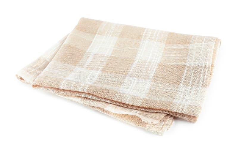 Asciugamano di cucina a quadretti piegato su bianco fotografia stock