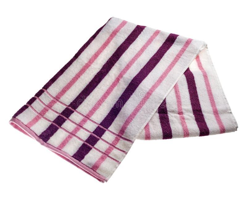 Asciugamano di spiaggia a strisce fotografia stock