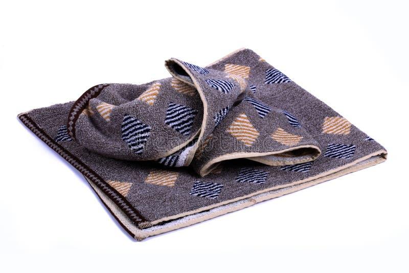 Asciugamano scuro con fondo bianco immagine stock