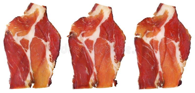Asciughi le fette curate del collo della carne di maiale isolate su fondo bianco fotografia stock