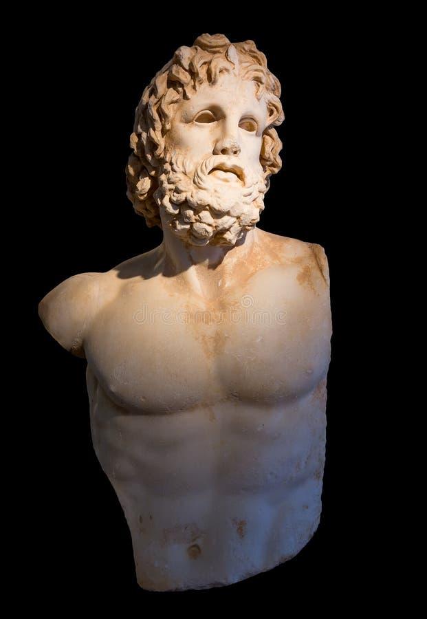 Standbeeld van god Asclepius met selectieve verlichting, zwarte achtergrond royalty-vrije stock foto's