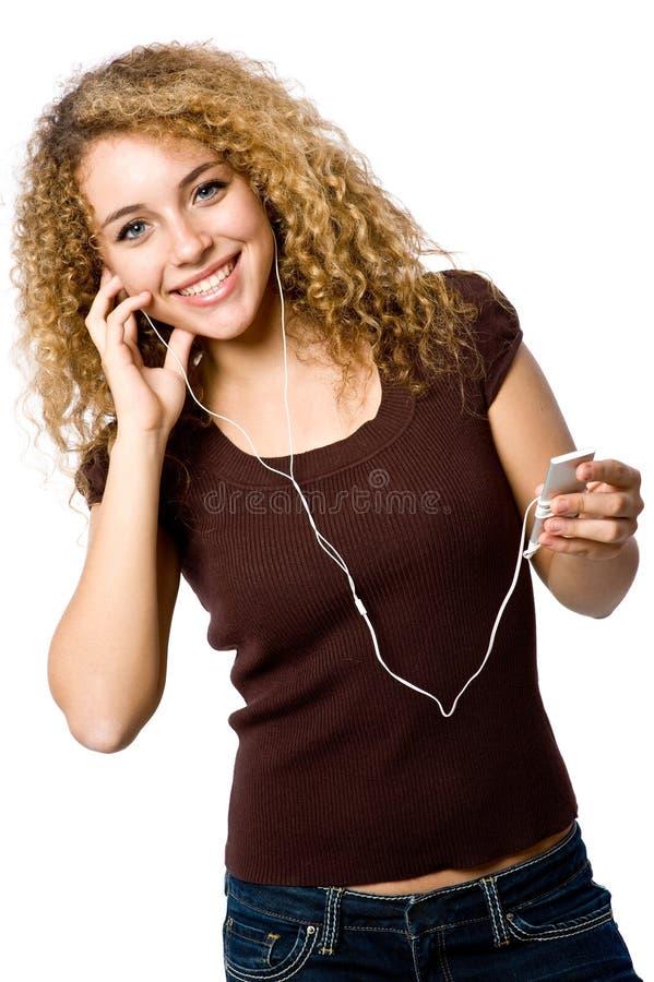 Download Ascoltando la musica fotografia stock. Immagine di capelli - 4957334