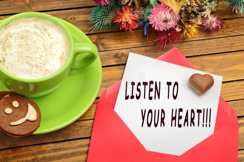 Ascolti le vostre citazioni del cuore fotografie stock