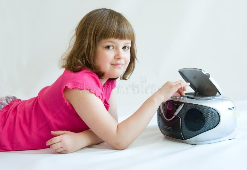 Ascolto della ragazza immagine stock libera da diritti
