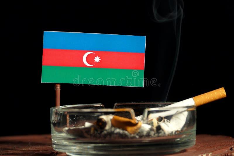 Download Aserbaidschan-Flagge Mit Brennender Zigarette Im Aschenbecher Lokalisiert Auf Schwarzem Stockbild - Bild von gewohnheit, neigung: 96932593