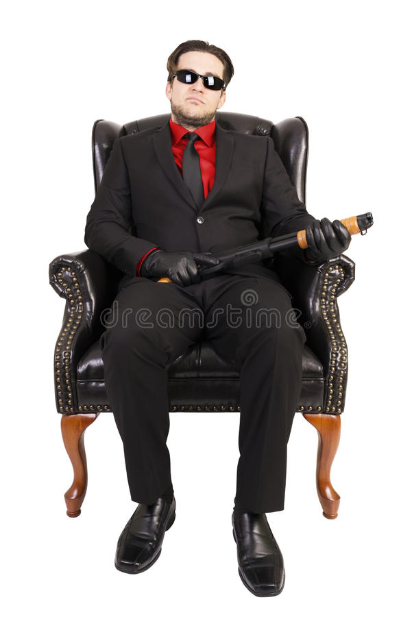 Asesino que se sienta en silla imagen de archivo