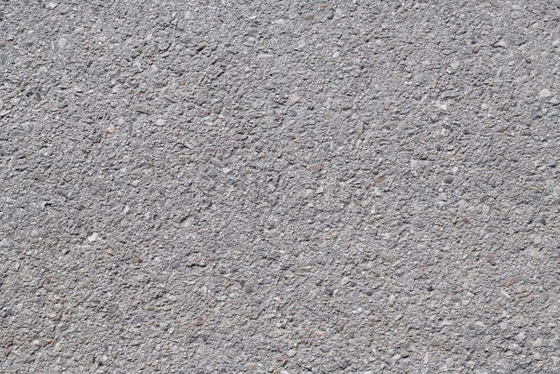Asfaltbakgrundstextur med n?got fint korn arkivfoton