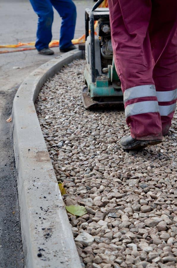 asfaltera att reparera fotografering för bildbyråer