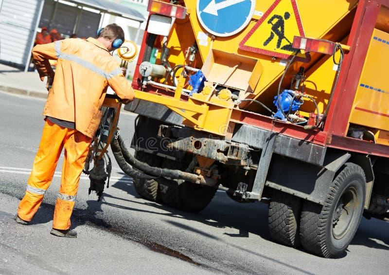 Download Asfaltowi łatań roadworks obraz stock. Obraz złożonej z popychadło - 28961283