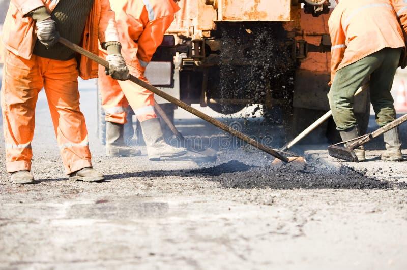 asfaltstenläggningarbeten royaltyfri fotografi