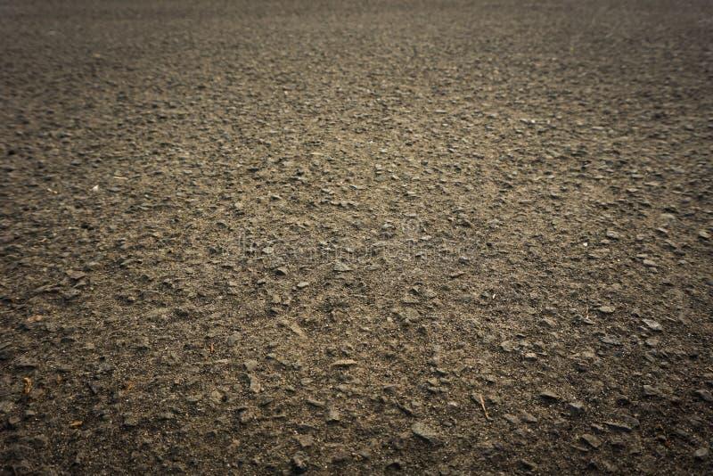 Asfalttextuur met grunge warme donkere kleur op de weg stock fotografie