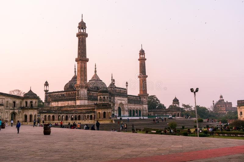 Asfi mosque in lucknow at sunset. Lucknow, India - 3rd feb 2018: The famed asfi mosque in the bara imambara complex in lucknow shot at dusk. This famous landmark stock photos