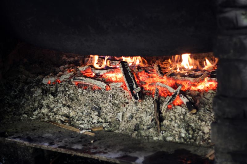 Ash and fire in fireplace. Ash and fire in fireplace Concept of warm stock image