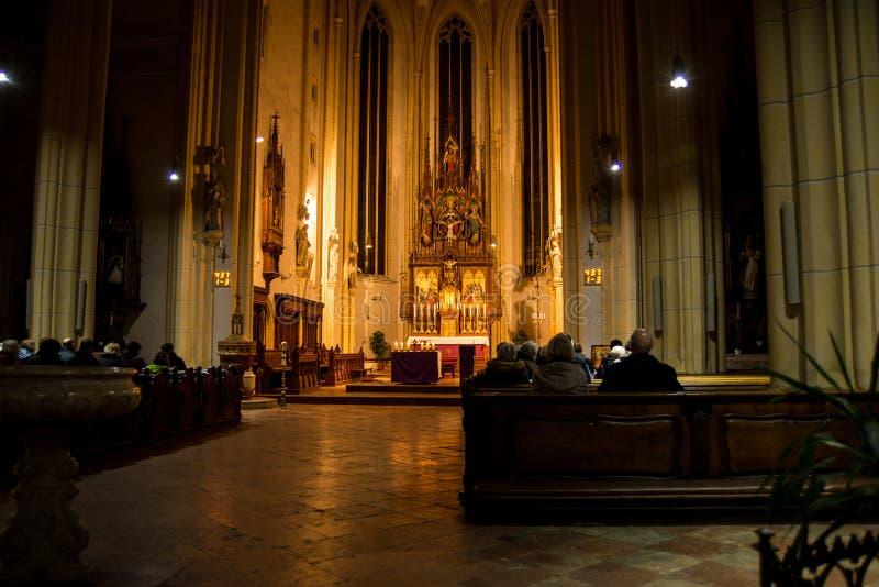 Ash Wednesday holy mass. Neuoetting,Germany-Feb 14,2018: Parishioners wait for Holy Mass to start on Ash Wednesday stock photography