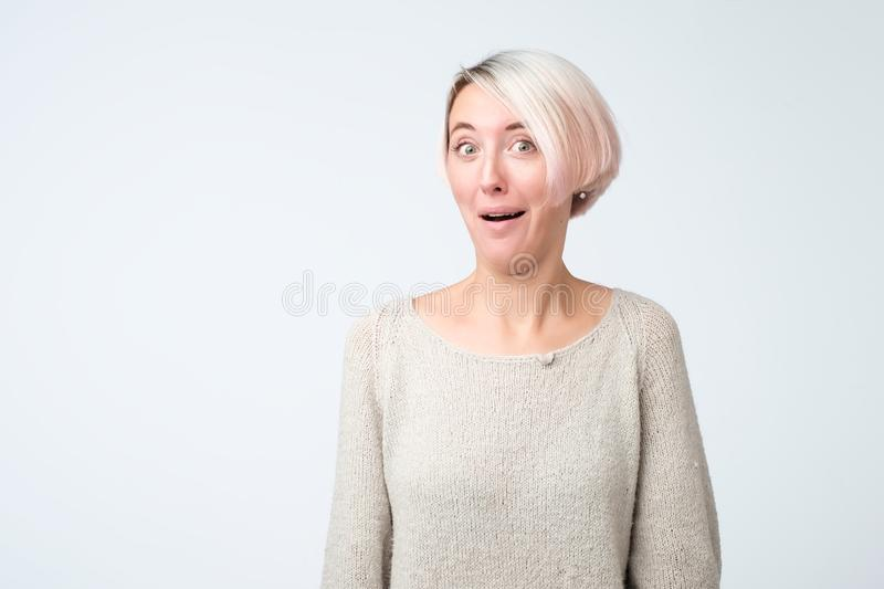 Ashamed or embarrassed european young woman. stock photos