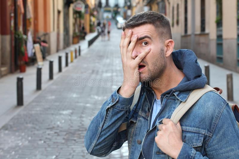 Ashamed man covering his face stock images