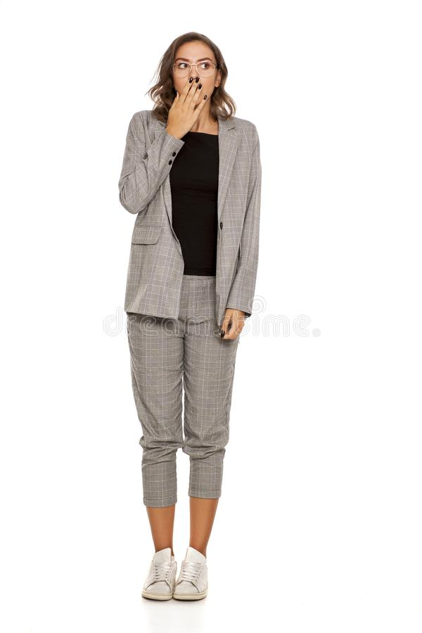 Ashamed woman in casual suit royalty free stock photos