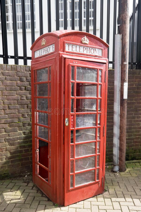 Ashford, Kent, United Kingdom - March 9, 2020: Broken red phone box in Ashford town centre. Is out of order royalty free stock images