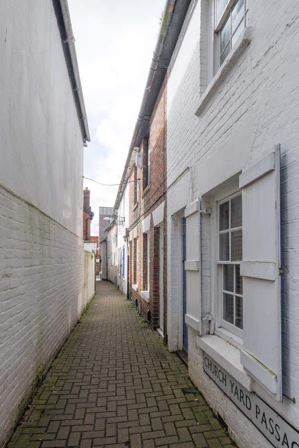 Ashford, Kent, United Kingdom - March 9, 2020: Looking down the narrow Church Yard Passage alleyway. Ashford, Kent, United Kingdom - March 9, 2020: Looking down stock photo