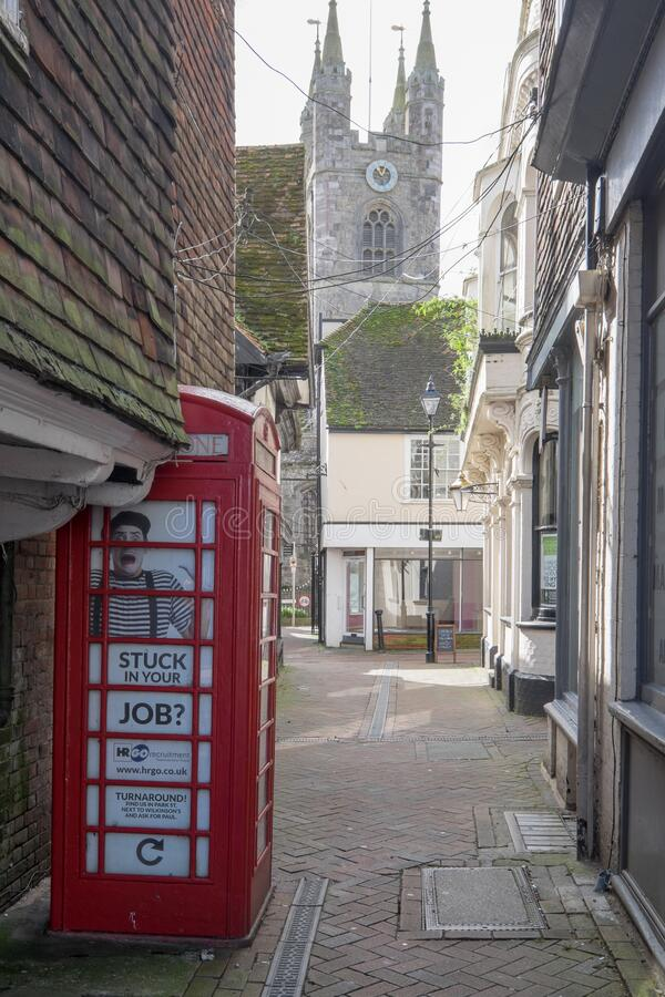 Ashford, Kent, United Kingdom - March 9, 2020: View from the High Street towards St Mary the Virgin church with phone box in. Ashford, Kent, United Kingdom stock photo
