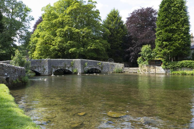 Ashford in the Water. The Sheepwash Bridge over the River Wye at Ashford in the Water,Derbyshire, England.So called as the bridge has an attached stone sheepwash royalty free stock images