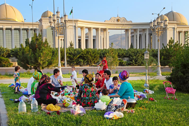 Ashgabad, Turkmenistan - August 1, 2014. Happy big family picnic stock photography