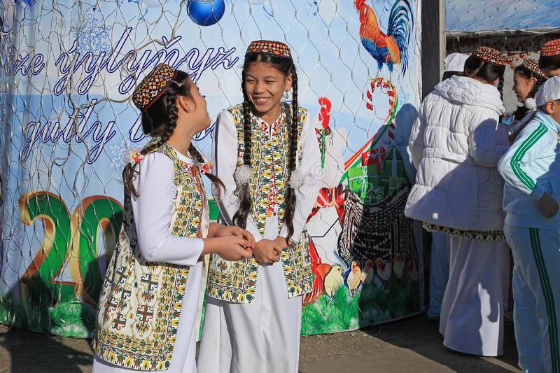 ASHGABAT, TURKMENISTAN - January, 04, 2017: Two unknown young girls in national clothes laugh and talk. ASHGABAT, TURKMENISTAN -. January, 04, 2017 stock images