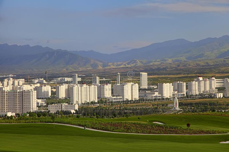 ASHGABAT, TURKMENISTAN. View of the new neighborhood on a background of mountains royalty free stock photos