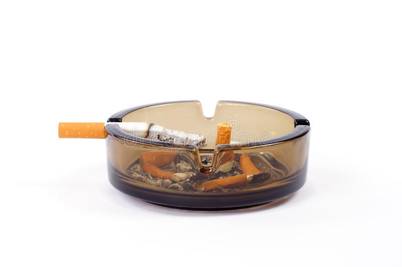 Ashtray. A flithy glass ash-tray photo on the white background royalty free stock images