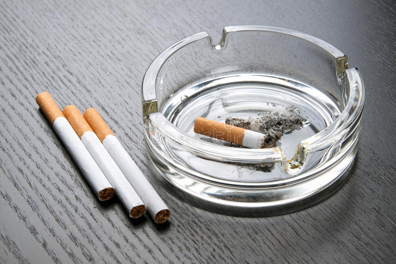 Ashtray. On a black table stock images