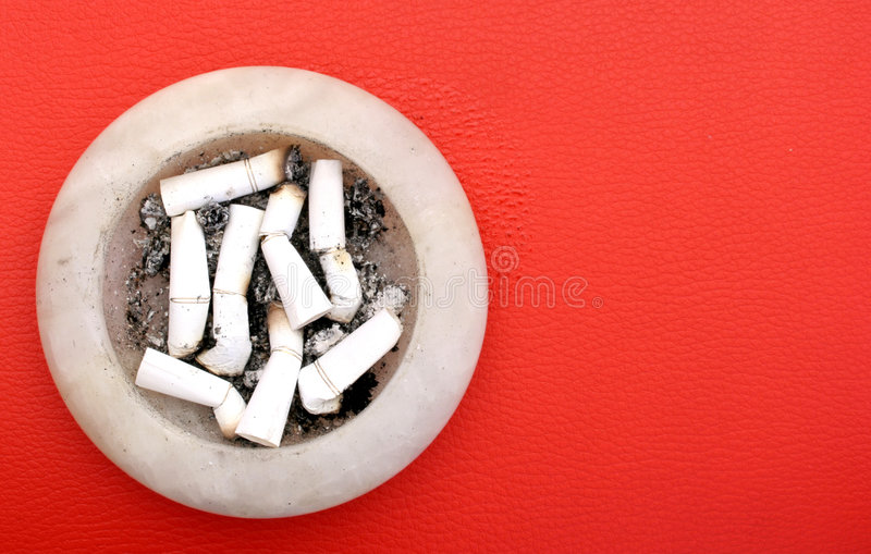 Ashtray. Placed over red copy space for text stock photography
