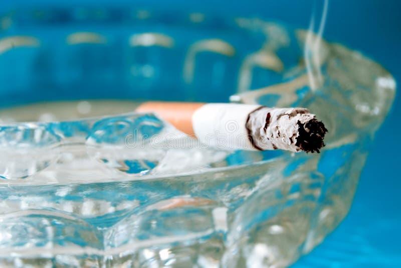Ashtray. Cigarette with smoke in ashtray stock photo