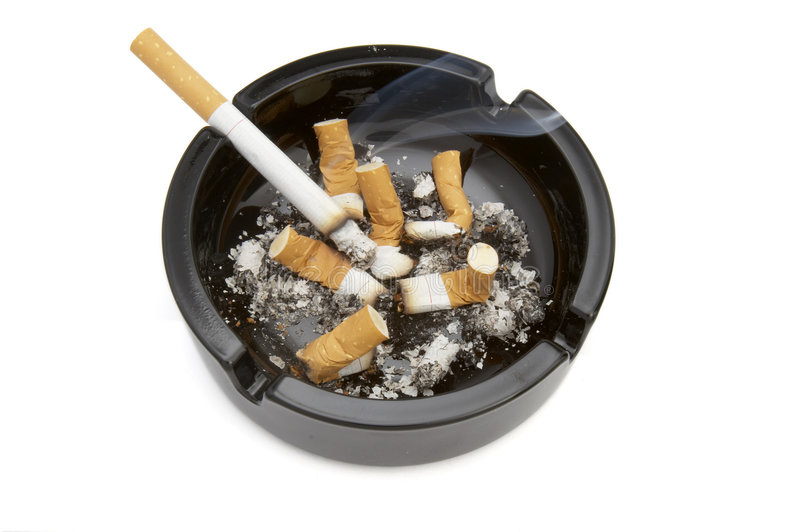 Ashtray 7. Close up of ashtray and cigarettes on white background with clipping path royalty free stock photos