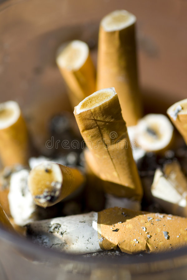 Ashtray. Full of cigarette butts royalty free stock photography