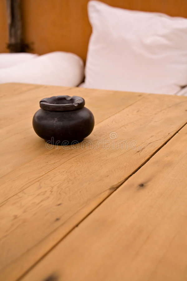 Ashtray on a table stock photography