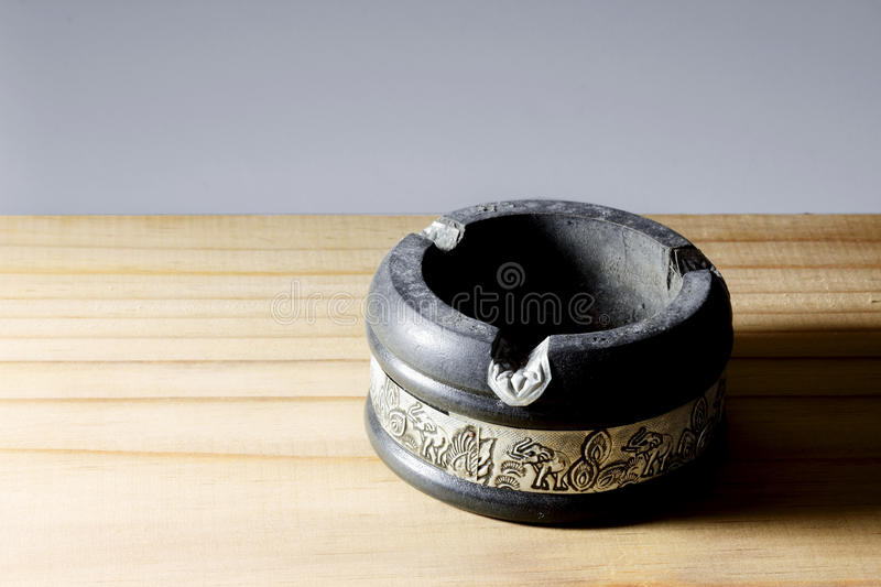 Ashtray. On Wood and Gray Background royalty free stock images