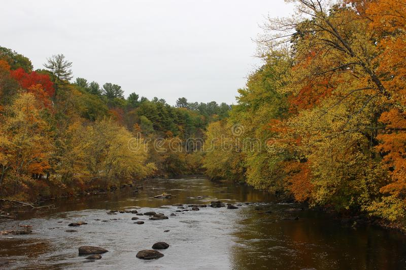 Ashuelot River in Winchester, New Hampshire. Ashuelot River on Winchester, New Hampshire in fall with great foliage royalty free stock photos
