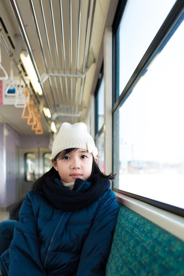 Asiático lindo en el tren fotografía de archivo libre de regalías