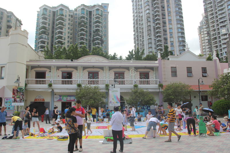 Asia,china,Shenzhen,the square interesting a. In Shenzhen Happy Valley square, the parents and children are participating in the square stock images