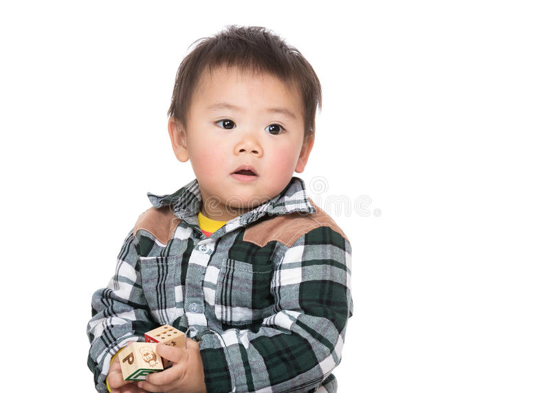 Asia baby boy hold with wooden toy block. Isolated on white royalty free stock photo