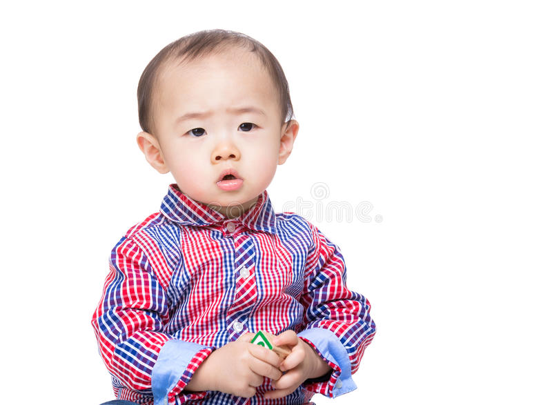 Asia baby boy holding toy block. Isolated on white stock photography