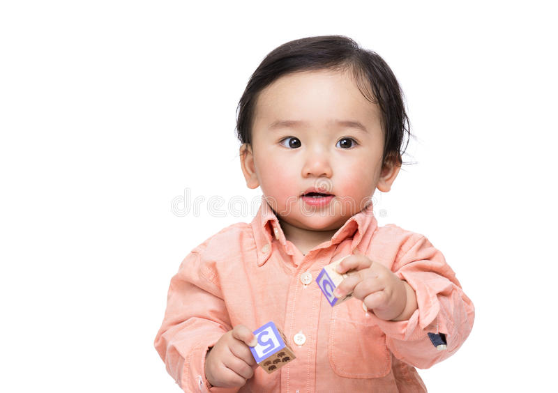 Asia baby boy holding wooden toy block. Isolated on white royalty free stock photo