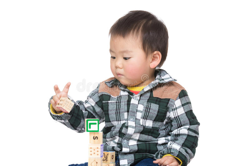 Asia baby boy play toy block. Isolated on white stock photos