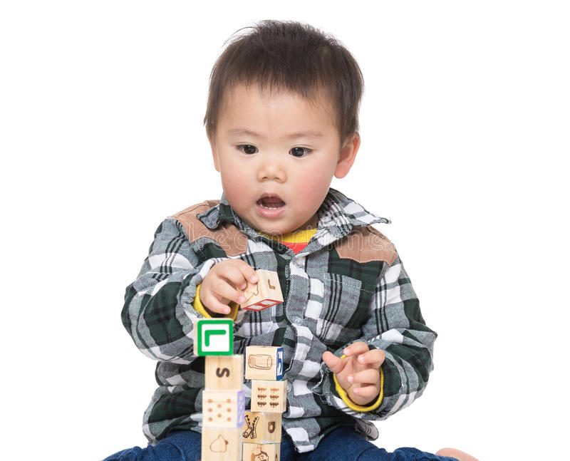 Asia baby boy play wooden toy block. Isolated on white royalty free stock photos