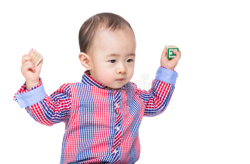 Asia baby boy throwing toy block. Isolated on white stock photo