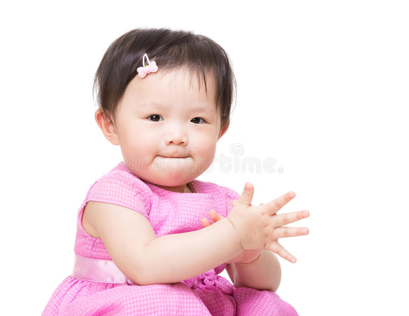 Asia baby girl clapping hand. Isolated on white royalty free stock photos