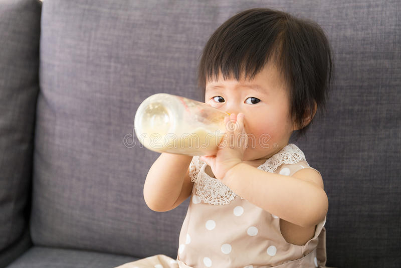 Asia baby girl having milk royalty free stock photo