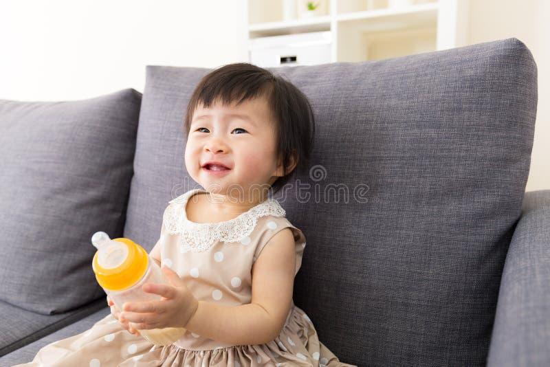 Asia baby girl holding milk bottle stock photos