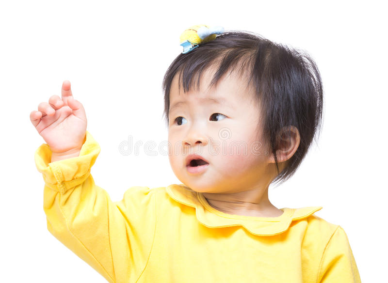 Asia baby girl looking aside and hand up stock photos